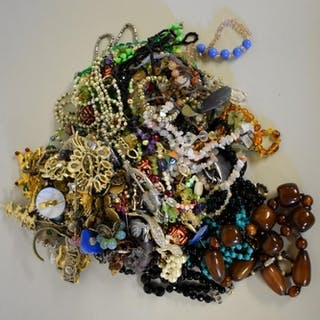 A quantity of costume jewellery, including beaded necklaces ...