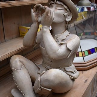 A stoneware figure of Peter Pan, 52.5cm high, (s.d.). ...