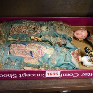 A pair of Chinese composition dolls, each with finely e...