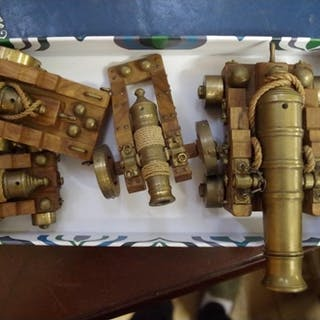 Four brass model cannons, each on walnut carriage, long...