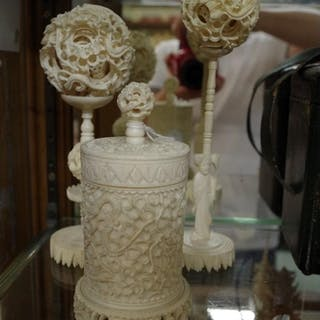 Two Chinese ivory concentric puzzle balls on stands; to...