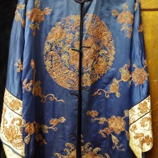 A Chinese embroidered silk jacket; together with an orange w...