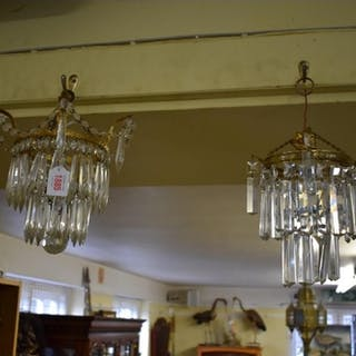 A brass and faceted glass drop two tier chandelier. ...
