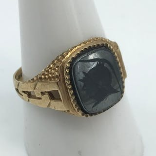 A Gents 9ct gold signet ring set with a black onyx stone eng...