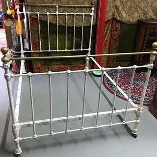 A Victorian double cast iron bed frame.