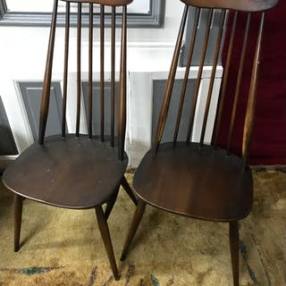 A Set of 4 Ercol elm wood spindle back chairs.