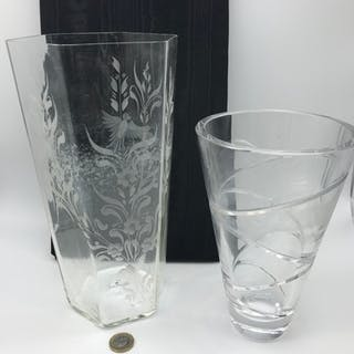 An hexagonal clear glass flower vase etched with birds, flow...