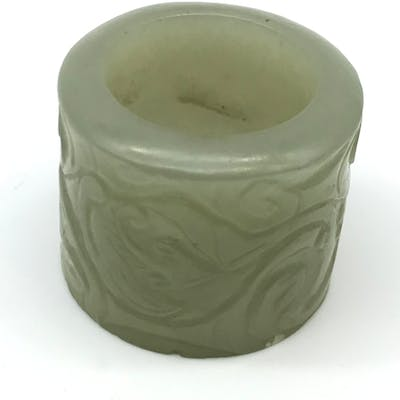 A 17th/ 18th century Chinese hand carved jade archers ring