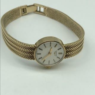 A 9ct gold ladies Longines wrist watch. In a working conditi...