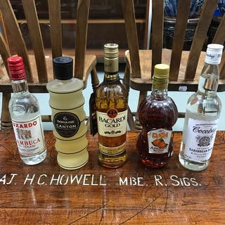 A Lot of five bottles of mixed spirits, Bacardi Gold 70cl, C...
