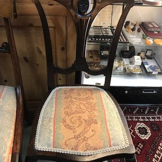 A Victorian ornate chair with swirl upholstery