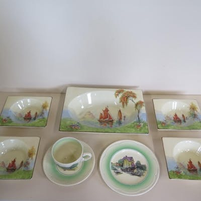 Four pieces of Clarice Cliff, a Newport Pottery rural scenes...