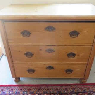 A 19th century stripped pine three drawer chest, 83cm tall, ...