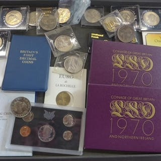 A collection of British and American coins, including commem...