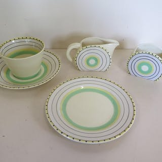 A Clarice Cliff tea cup, saucer, tea plate, sugar bowl and m...