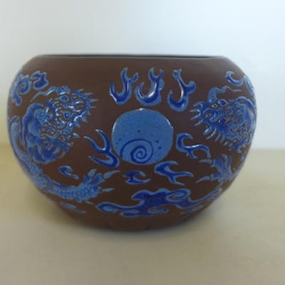 An unusual Yixing gourd-shape bowl, decorated with two drago...