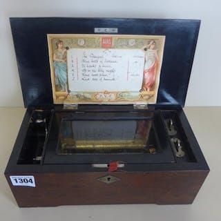 A walnut music box playing 6 Airs, all teeth present, motor ...