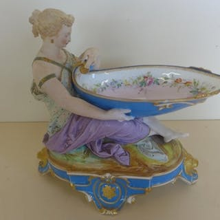 A 19th century porcelain figural sweet meat dish, 21cm tall ...
