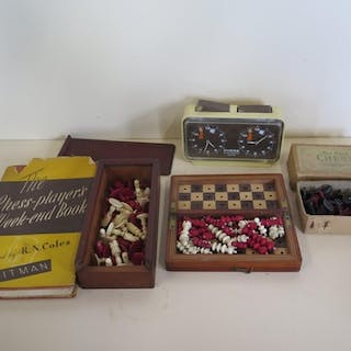 Two bone chess sets, circa 1880 one of the travelling type,...
