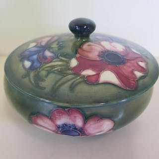 A Moorcroft clematis decorated lidded bowl, 14cm in diameter...