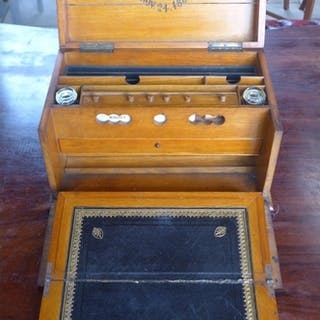 A 19th century walnut stationary/writing box, dated 24th Nov...