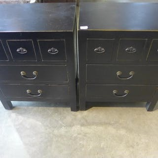 A pair of black five drawer bedside chests, 60cm tall x 50cm...
