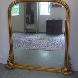 A Victorian style gilt over mantle mirror, 138cm tall x 133c...