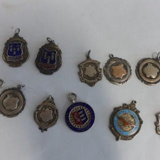 A collection of eleven silver fobs including RAF cycling ass...