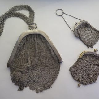 A white metal chain link opera bag, and two plated open purs...