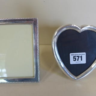 A pair of silver photo frames, largest 13x10cm