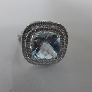 An 18ct white gold diamond and aquamarine ring, size N, 7.7 ...