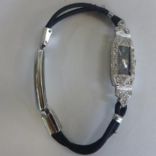 A platinum and diamond ladies manual wind cocktail watch, to...