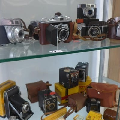 A collection of eight vintage 35mm cameras including Kodak R...