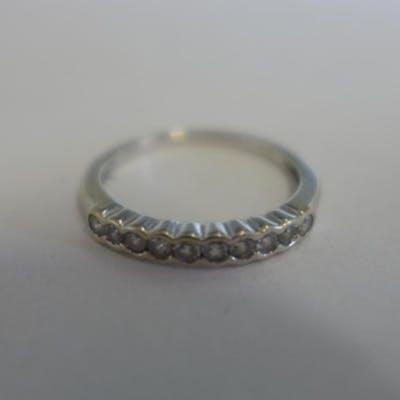 An 18ct white gold, ten stone diamond ring, approx total 0.2...