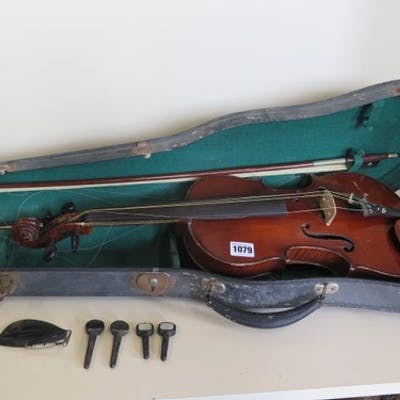 A late 19th/early 20th century violin in case with bow, moth...