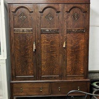 WARDROBE, 203cm H x 158cm x 51cm circa 1920, oak with three ...