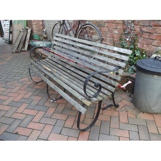 Wooden Slatted Garden Bench Having Shaped Metal Supports Current