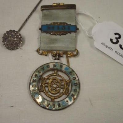 Silver stick pin, and a silver and enamel Masonic medal.
