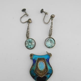 An Art Nouveau silver coloured metal and enamel pendant and ...