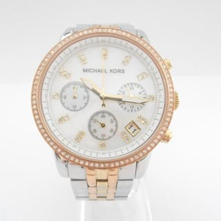 A lady's Michael Kors wristwatch in box and two other ladies...