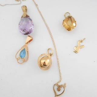 A 9ct. gold pendant set amethyst, a fine 9kt, gold chain wit...