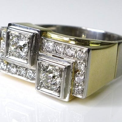 An 18ct gold and diamond Art Deco style ring, formed as two ...