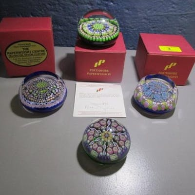 A group of four Perthshire glass paperweights to include PP1...