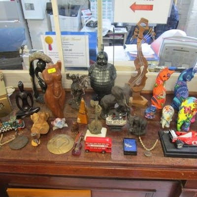 A miscellaneous lot of wooden sculptures, resin elephants, l...