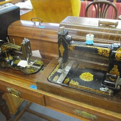 An early 20th century Gustave Winselmann sewing machine, an ...