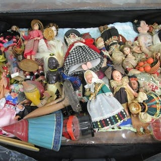 A quantity of souvenir dolls from around the world