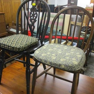 A matched set of eight 20th century beech Windsor chairs wit...