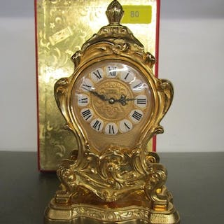 An Imhof Jubilee gold metal cased mantel clock in the Louis ...