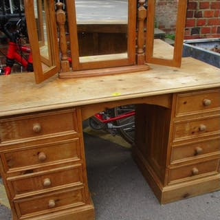 A two pedestal pine desk with a pine dressing table mirror