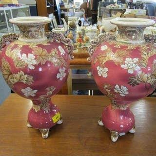 A pair of Satsuma vases with twin handles and floral decorat...